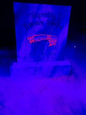 Jimmy Snuka - A tombstone commemorating Snuka's loss at WrestleMania VII