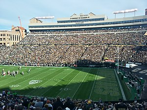 "Folsom Field - The east side of the stadium with the newer club and suite level suites; ""1990 National Champions"" noted between the two suite levels"