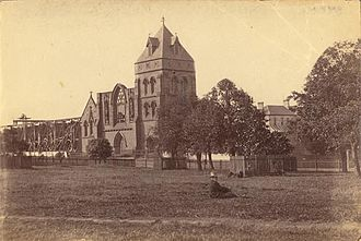 James Dempsey (builder) - The former St Mary's Cathedral, Sydney, ca. 1870 (built 1843, destroyed by fire 1865) showing surviving belltower built to designs by A W N Pugin. St Mary's Cathedral.