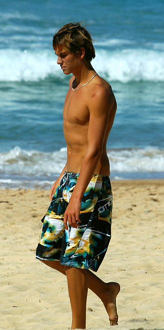 Boardshorts - A young man wearing boardshorts
