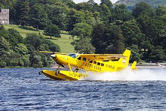 Floatplane - Amphibious Caravan taking off from Loch Lomond in Scotland