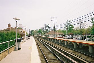 Garden City station (LIRR) - The two station houses of Garden City's Long Island Rail Road Station, looking east.