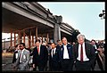 George H. W. Bush (along with Mayor Wilson, Congressman Pete Stark to the right) touring the site of the collapsed I-880 Cypress Structure. Congressman George Miller is to George Bush's left (21632784174).jpg