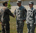 German Army Master Sgt. Alexander H. Goeb, left, a liaison with the U.S. Army XVIII Airborne Corps, shakes hands with U.S. Army Maj. Greg Pieper, with Alpha Company, 256th Combat Support Hospital, after 100711-A-NW222-004.jpg