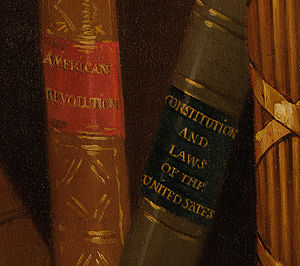 "Lansdowne portrait - Detail of the book bindings in the White House's copy of the Lansdowne portrait. ""UNITED STATES"" is misspelled as ""UNITED SATES"" to mark the copy."