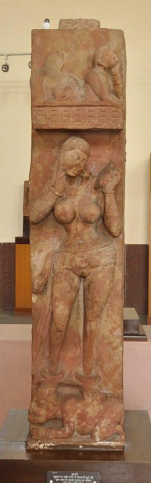 Bhutesvara Yakshis - Image: Graceful Young Lady Standing on Dwarf Looking into Mirror to Adjust Her Pendant and Reverse Depicting Jataka Story Circa 2nd Century CE Bhuteshwar ACCN 00 J 5 Government Museum Mathura 2013 02 23 5754