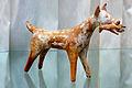 Greek terracotta statue dog with pray Staatliche Antikensammlungen SL 120.jpg