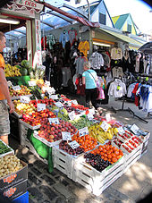Stalls selling fruit and clothing