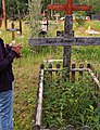 Gwich'in woman visits grave of elder relative at Birch Hill Cemetery, Fairbanks, Alaska.jpg