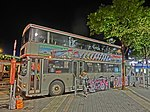 HK TST night Salisbury Road Star Ferry Piers Bus Terminus KMBus 8 stop body ads DOCG La Genisia Mar-2013.JPG