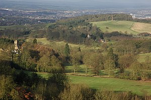 Hagley Hall - Hagley Park in the foreground, with the Hagley Obelisk on Wychbury Hill in the middle-ground,  viewed from the neighbouring Clent Hills