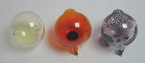 Halogen - From left to right: chlorine, bromine, and iodine at room temperature. Chlorine is a gas, bromine is a liquid, and iodine is a solid. Fluorine could not be included in the image due to its high reactivity, and astatine due to its radioactivity.