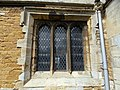Harlaxton Ss Mary and Peter - exterior South Aisle west window.jpg