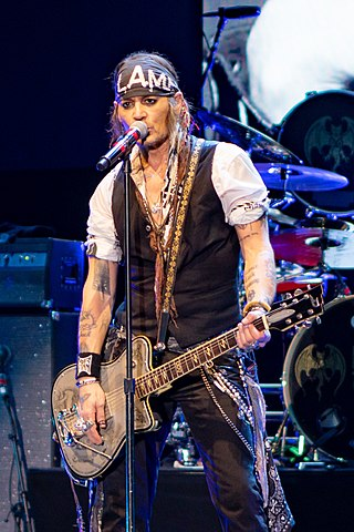 Depp performing with Hollywood Vampires at Wembley Arena in June 2018