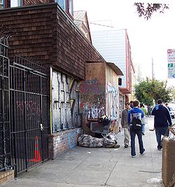 On an otherwise upscale section of Church Street, a homeless person takes refuge in front of a constructions site.  Chronic homelessness was a major issue in the 2003 mayoral campaign.