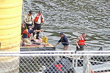 FBI and Hennepin County recovery operations lowering sonar into the river