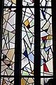 Interieur, overzicht van het onderste deel van het venster met glas-in-loodramen links in het koor - Paterswolde - 20531312 - RCE.jpg
