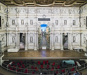 """Teatro Olimpico - Scaenae frons of the Teatro Olimpico. The large arch in the center is known as the porta regia or """"royal arch""""."""