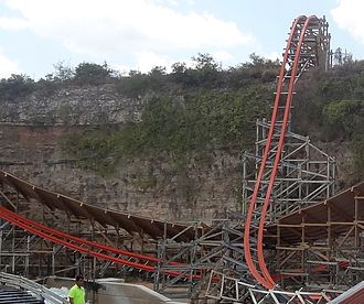 Iron Rattler - Iron Rattler uses overbanked turns and steel track