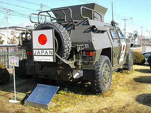 Japanese Iraq Reconstruction and Support Group - A Komatsu LAV on display with Japanese Iraq Reconstruction and Support Group markings during a public exhibition. Note the shield on top of the vehicle to protect standing JGSDF soldiers from gunfire at all sides.