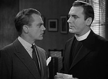 Head and shoulders shot of Cagney talking to a man in a clerical collar.