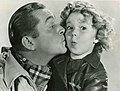 """James Dunn and Shirley Temple publicity photo for """"Bright Eyes"""" - front (cropped).jpg"""
