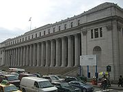 Farley post office in NYC with quotation inscribed above the columns.