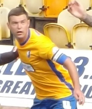 John Dempster (footballer) - Dempster playing for Mansfield Town in 2013