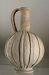 Jug, Cypriot imitation of Mycenaean IIIC pottery (buff slip and decoration in relief). Late Bronze III. From tomb 419, 8 at Enkomi, north-western Cyprus.