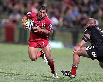 Karmichael Hunt - Hunt playing for the Queensland Reds