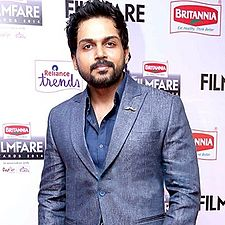 A picture of Karthi as he looks at the camera