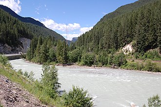 Kicking Horse River - Kicking Horse River at Park Bridge rest area near Golden. Trans Canada Highway on left, CPR mainline on right