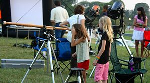 White House Astronomy Night - Children gazing through a replica of Galileo's telescope at the 2010 event held on the National Mall