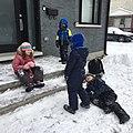 Kids waiting for the school bus, enjoy the snow. (44157464050).jpg