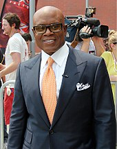 An image of L.A. Reid dressed in a black suit.