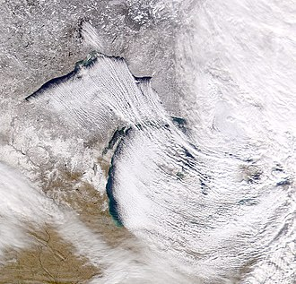 Snow - Cold northwesterly wind over Lake Superior and Lake Michigan creating lake-effect snowfall.