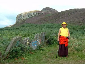 Yeshe Losal - Lama Yeshe Losal Rinpoche on Holy Island with stones decorated with the mantra Om Mani Peme Hung