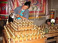 Lamp Filling Ritual in a Buddhist Temple in Sikkim India.JPG