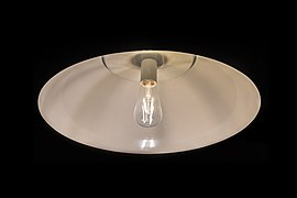 Lamp with lit incandescent light bulb and black background.jpg
