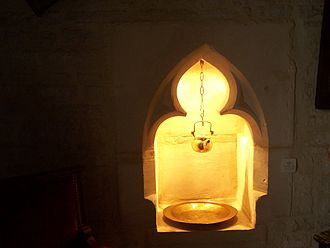 Ablution in Christianity - A 14th-century lavabo as a niche recessed into the side wall of a sanctuary in Amblie, Normandy.