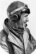Head-and-shoulders profile of moustachioed man in leather flying helmet