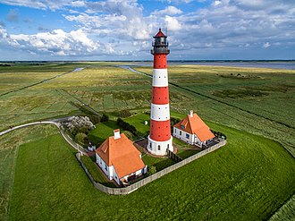Aerial photography - An aerial photograph using a drone of Westerheversand Lighthouse, Germany.