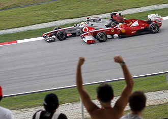 2011 Malaysian Grand Prix - Lewis Hamilton and Fernando Alonso battle during the race.