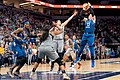 Lindsay Whalen (13) is guarded by Kelsey Plum (10) as she takes a shot in the Lynx vs Aces game.jpg
