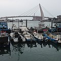 Lover Bridge and fishing boats in Tamsui - 2015.jpg