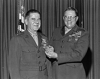 Leo J. Dulacki - Dulacki (left) receives his second Distinguished Service Medal by Commandant Robert E. Cushman Jr. during his retirement ceremony on December 28, 1973.