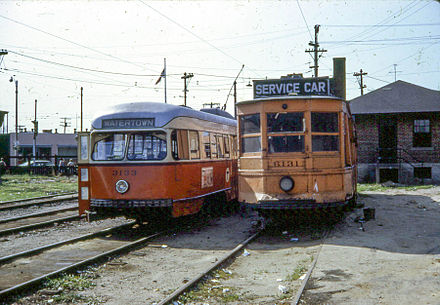 A PCC streetcar (left) and a work car in Watertown Yard in 1967 MBTA 3133 and 6131 at Watertown.jpg
