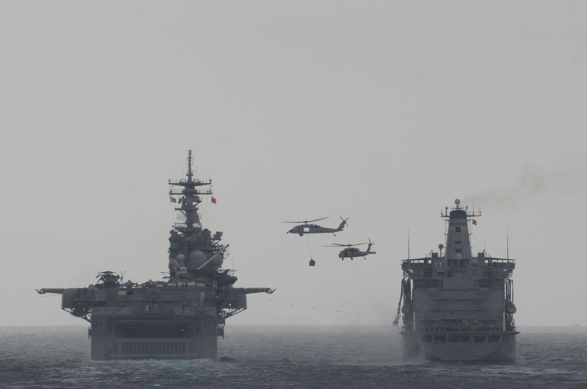 https://upload.wikimedia.org/wikipedia/commons/thumb/c/c6/MH-60S_Seahawk_helicopters_transfer_supplies_during_a_vertical_replenishment_between_the_amphibious_assault_ship_USS_Boxer_%28LHD_4%29%2C_left%2C_and_the_fleet_replenishment_oiler_USNS_Rappahannock_%28T-AO_204%29_March_17_110317-N-RC734-183.jpg/1920px-thumbnail.jpg
