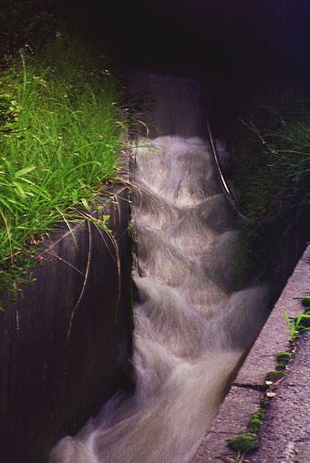 An agricultural drainage channel outside Magome, Japan after a heavy rain. Note that protuberances create turbulent water, preventing sediment from settling in the channel. MagomeDrainage.jpg