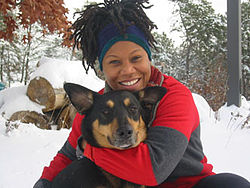 Portrait photo of an African-American woman with her dog.
